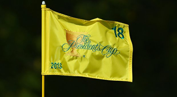 A Presidents Cup flagstick is seen on the 18th green prior to the start of the event at the Muirfield Village Golf Club.