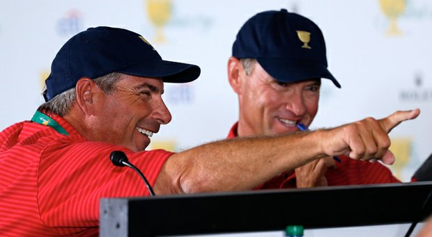 U.S. captain Fred Couples works with his assistant captain Davis Love III on the pairings for the Day 1 four-ball matches prior to the start of The Presidents Cup.