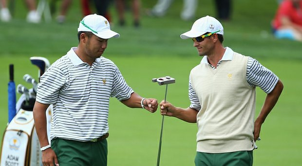 Hideki Matsuyama (left) and Adam Scott during their halve in the opening day of the 2013 Presidents Cup at Muirfield Village.