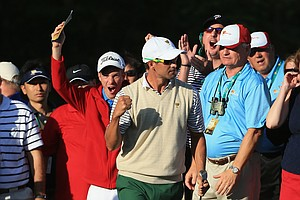 International Team's Adam Scott celebrates his third shot on the 15th hole during the Day 1 Four-Ball Matches at the Muirfield Village Golf Club for the Presidents Cup.