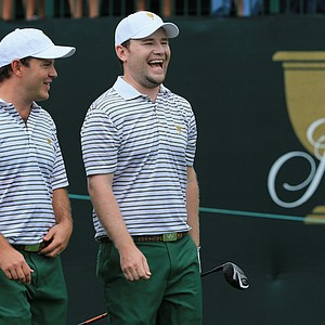 Richard Sterne and Branden Grace of the International Team walk off the first tee during Day 1 Four-Ball Matches at the Presidents Cup.