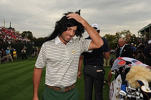 Charl Schwartzel of the International Team arrive at the first hole wearing a wig during the Day 1 Four-Ball Matches of The Presidents Cup at the Muirfield Village Golf Club.