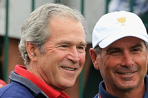 President George W. Bush poses with U.S. Team Captain Fred Couples on the first tee before the start of the Day One Four-Ball Matches at the Presidents Cup.