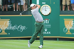 International's Jason Day hits his tee shot on the first hole during the Day 1 Four-Ball Matches during the Presidents Cup.