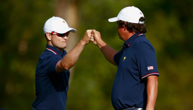 Zach Johnson and Jason Dufner of Team USA celebrate a birdie on the ninth hole during the Day 1 Four-Ball Matches.
