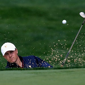 Jordan Spieth of the U.S. Team hits a bunker shot on the seventh hole during the Day 1 Four-Ball Matches at the Muirfield Village Golf Club for the Presidents Cup.