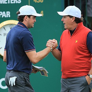 Phil Mickelson and his partner Keegan Bradley of the U.S. Team shake hands on the first tee during the Day 1 Four-Ball Matches at the Muirfield Village Golf Club.