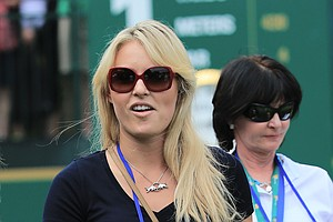 Olympic skiier Lindsey Vonn follows the play of Team USA's Tiger Woods at the Presidents Cup.