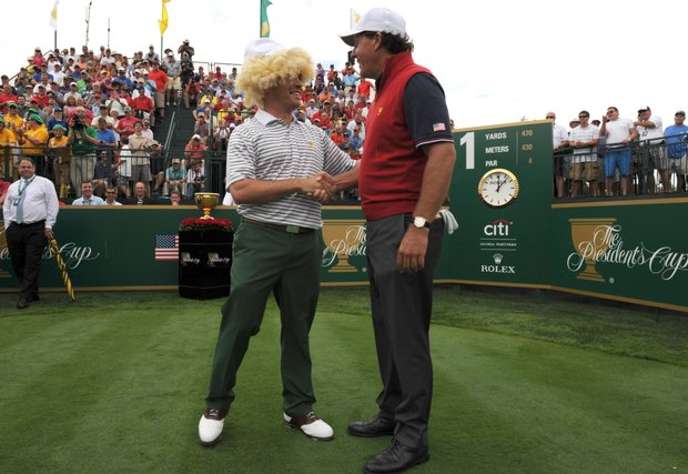Louie Oosthuizen of the International Team shakes hands with Phil Mickelson of the U.S. on the first hole during the Presidents Cup.
