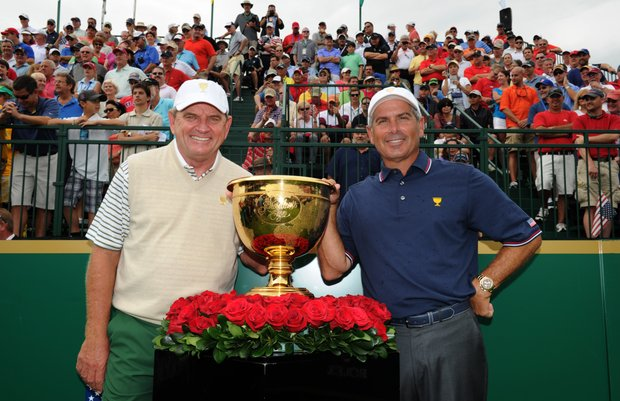 International team Captain Nick Price and U.S. Team captain Fred Couples pose for a photo on the first hole at Muirfield Village.