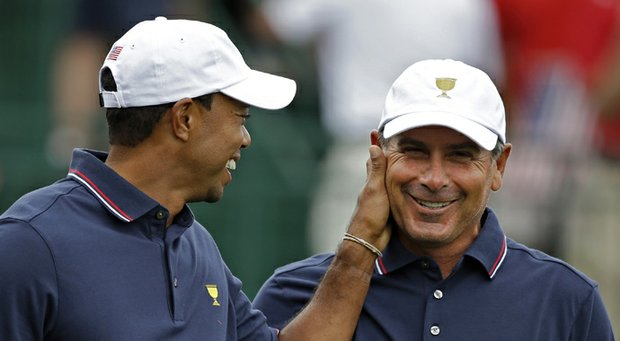 Tiger Woods jokes with Fred Couples during the 2013 Presidents Cup at Muirfield Village.
