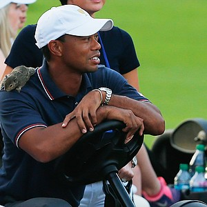A squirrel is seen on the shoulder of USA's Tiger Woods during the Day 1 Four-Ball Matches at the Muirfield Village Golf Club for the Presidents Cup.