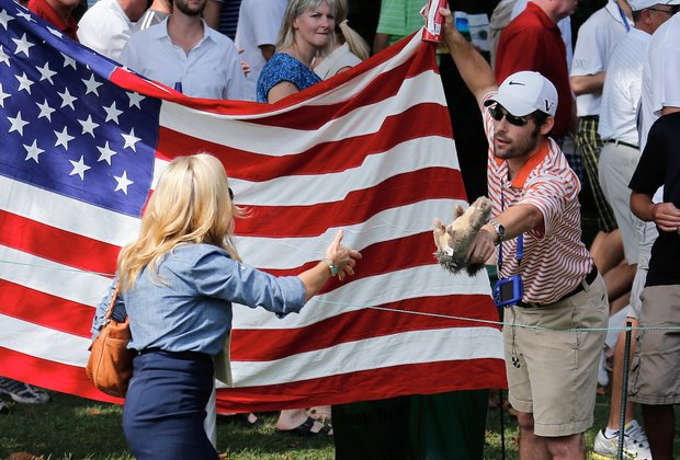 A fan offers a toy squirrel to Amy Mickelson of the U.S. on the second hole during the Day 2 foursome matches at Muirfield Village.