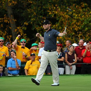 Branden Grace of the International team reacts to his birdie putt on the seventh hole during the second round of the Presidents Cup.