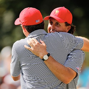 Keegan Bradley (left) and Phil Mickelson of the U.S. save par on the second hole during the Day 2 foursome matches at Muirfield Village.