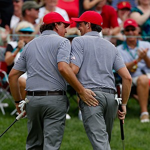 Phil Mickelson (left) and Keegan Bradley of the U.S. celebrate after making eagle on the fifth hole during the Day 2 foursome matches at Muirfield Village.