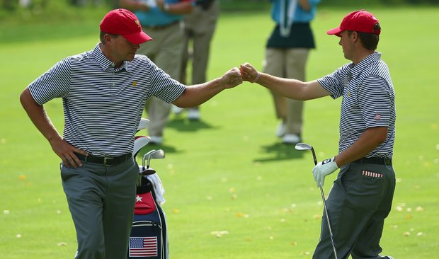 Steve Stricker (left) and Jordan Spieth of the U.S. react to a shot in the second fairway during the Day 2 foursome matches at Muirfield Village.