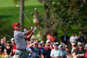 Tiger Woods of the U.S. watches his approach shot on the first hole during the Day 2 foursome matches at Muirfield Village.
