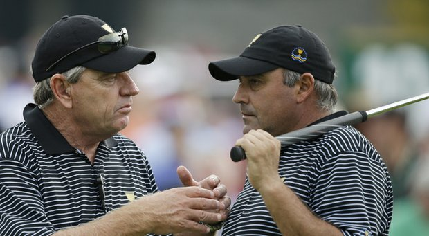 Angel Cabrera (right) talks with Internationals captain Nick Price during Day 2 of the Presidents Cup at Muirfield Village.