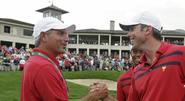 Matt Kuchar, captain Fred Couples (left) and Tiger Woods (rear) celebrate a successful Saturday morning at the 2013 Presidents Cup in Muirfield Village.