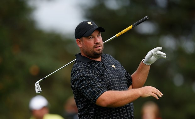 Brendon de Jonge of the International team reacts to a poor tee shot on the 16th hole during the weather-delayed foursome matches.