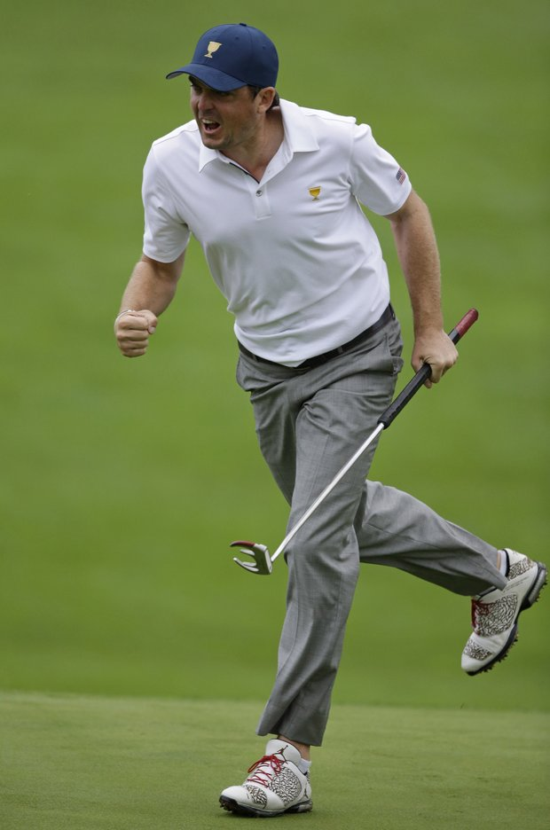 Keegan Bradley reacts after making a birdie putt on the 18th hole during the foursome match at the Presidents Cup.