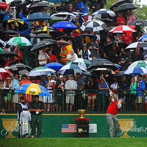 Phil Mickelson of the U.S. hits a tee shot in the rain on the first hole during the final round of the Presidents Cup.