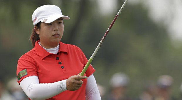 China's Shanshan Feng takes aim before she tees off on the fourth hole during the final round of the Reignwood LPGA Classic.