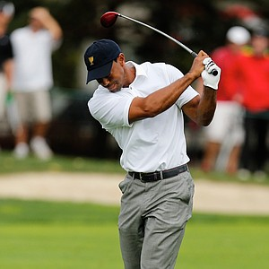 Tiger Woods of the U.S. reacts to a poor shot on the sixth hole during the Sunday singles matches at Muirfield Village.
