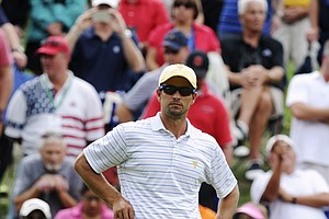 International Team's Adam Scott watches the action during the Day 3 Four-ball Matches at the Muirfield Village Golf Club.
