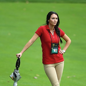 Amanda Dufner watches the action during the Day 4 Singles Matches at the Muirfield Village Golf Club for The Presidents Cup.
