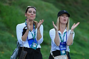Ellie Day (L) and Ruby DeLaet watch the play of the International Team during the Day 1 Four-Ball Matches.