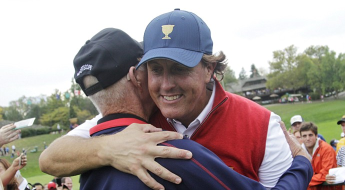 Phil Mickelson hugs his father, Phil Sr., after the U.S.' win in the 2013 Presidents Cup at Muirfield Village.