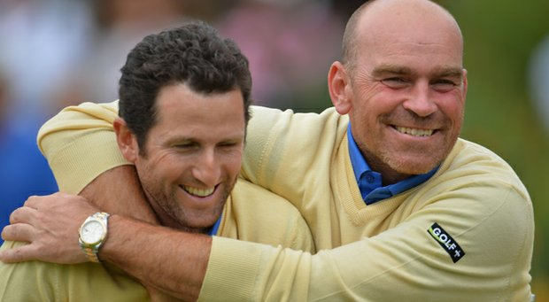 Gregory Bourdy, the first Continental Europe player to win five points in a Seve Trophy, celebrates with Thomas Bjorn during their team's win in the 2013 tournament.