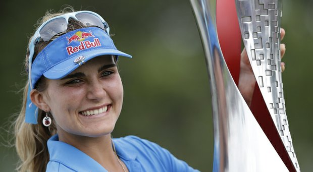 Lexi Thompson holds the trophy after winning the LPGA Malaysia in Kuala Lumpur on Sunday.