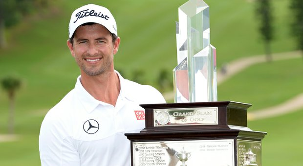Adam Scott with the winners trophy after the final round of the PGA Grand Slam of Golf at Port Royal GC in Southampton, Bermuda.