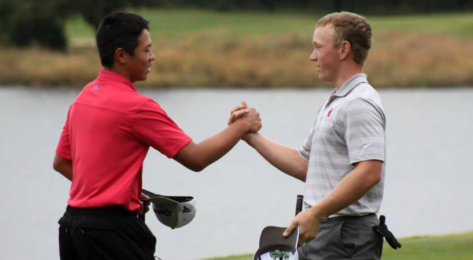 Andy Zhang, left, congratulates Brad Dalke on his victory at the 2013 Ping Invitational.