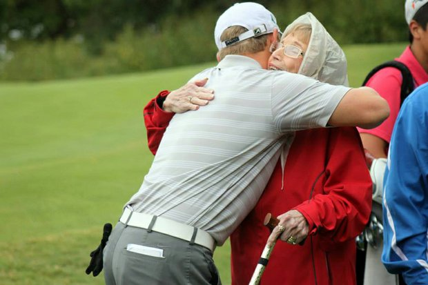 Brad Dalke hugs his grandmother, Barbara Dalke, after winning the 2013 AJGA Ping Invitational.