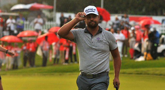 Ryan Moore (shown) and Gary Woodland will have to wait until Monday for the winner of CIMB Classic.