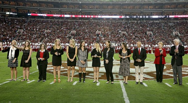 Emma Talley and her Alabama teammates receive their 2013 SEC Championship rings.