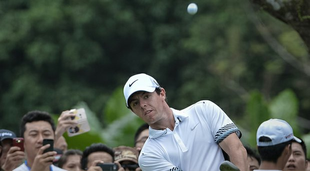 Rory McIlroy plays a new Nike ball during a 2013 exhibition against Tiger Woods in China.