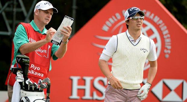 Ryo Ishikawa with caddie Simon Clarke at the HSBC Champions on Thursday.