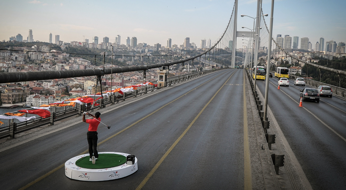 Tiger Woods hits a drive Tuesday on the Bosphorus Bridge, which connects Europe and Asia.