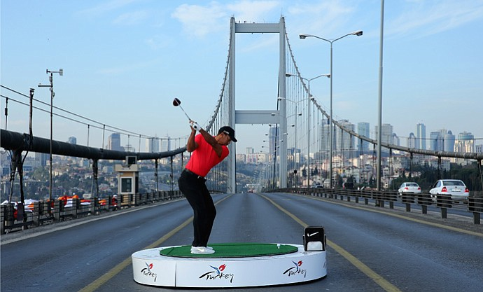 Tiger Woods hitting a golf ball across the Bosporus Bridge in Istanbul, Turkey on Tuesday.