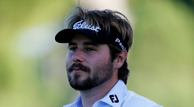 Victor Dubuisson looks on before he hits his second shot the 13th hole during the third round of the Turkish Airlines Open.