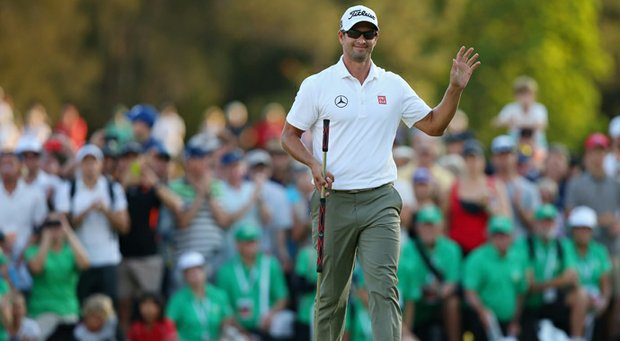 Adam Scott waves to the crowd on the 18th green after winning the Australian PGA.