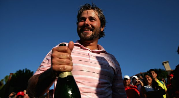 Victor Dubuisson celebrates his victory at the Turkish Airlines Open.