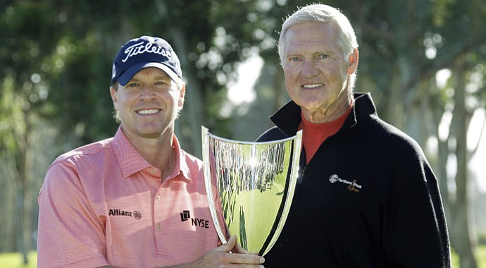 Jerry West, right, with Steve Stricker after Stricker's victory at the 2010 Northern Trust Open. West is stepping down as the tournament's executive director.