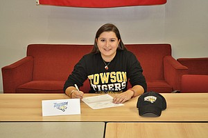 Alexis Hios signed with Towson on Wednesday.
