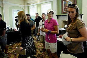 Lydia Ko, center, in the media center after her press conference at the CME Group Titleholders at Tiburon Golf Club in Naples, Fla.